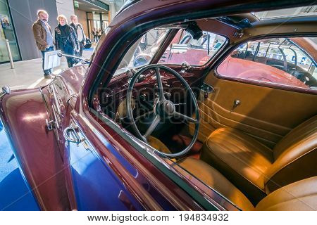 STUTTGART GERMANY - MARCH 17 2016: Cabin of large family car Peugeot 402 Legere E 1939. HDRi. Europe's greatest classic car exhibition