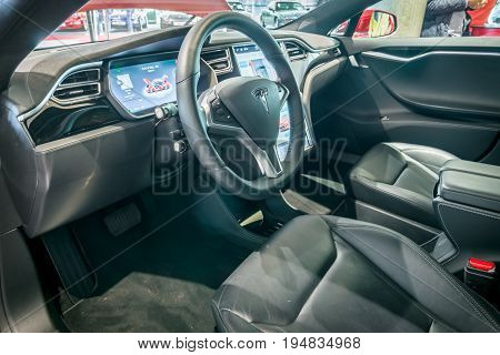 STUTTGART GERMANY - MARCH 17 2016: Cabin of full-size luxury car Tesla Model S AWD 90D 2015. Europe's greatest classic car exhibition