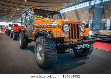 STUTTGART GERMANY - MARCH 17 2016: Off-road Jeep Wrangler Renegade 1994.Tilt-Shift. Europe's greatest classic car exhibition