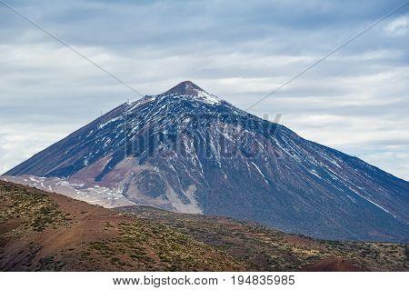 Teide volcano with snow on it's slopes. El Teide national reserve, Tenerife island, Spain