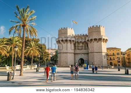 Valencia Spain - June 2 2017: Tourists walk in front of The Serrans Gate or Serranos Gate Valencian Towers is part of the ancient city wall. Landmark of Valencia