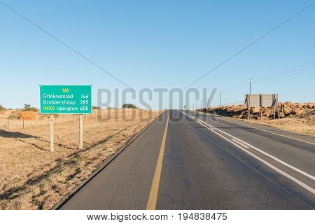 A distance road sign on the N8 road between Kimberley and Griekwastad in the Northern Cape Province of South Africa
