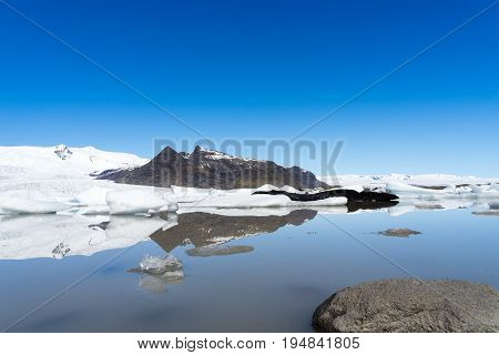 The small glacier lagoon is a unique place with icebergs constantly breaking off from the glacier and eventually drifting through the short river to the sea