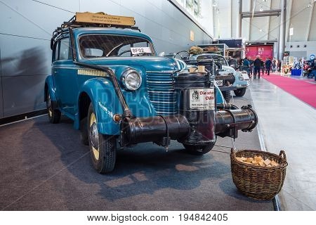 STUTTGART GERMANY - MARCH 18 2016: Compact car Opel Olympia OL38 1938 with wood gas generator by Zanker 1942. Europe's greatest classic car exhibition