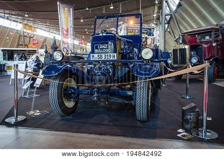 STUTTGART GERMANY - MARCH 18 2016: The tractor Lanz Bulldog D2531 (two-stroke hot bulb engine) manufactured by Heinrich Lanz AG in Mannheim 1939. Europe's greatest classic car exhibition