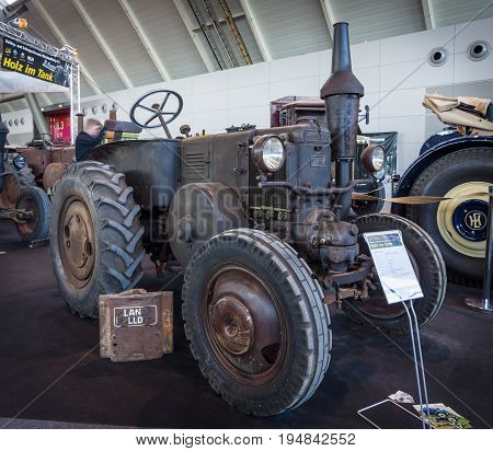STUTTGART GERMANY - MARCH 18 2016: The tractor Lanz Bulldog D7511 (two-stroke hot bulb engine) manufactured by Heinrich Lanz AG in Mannheim 1935. Europe's greatest classic car exhibition