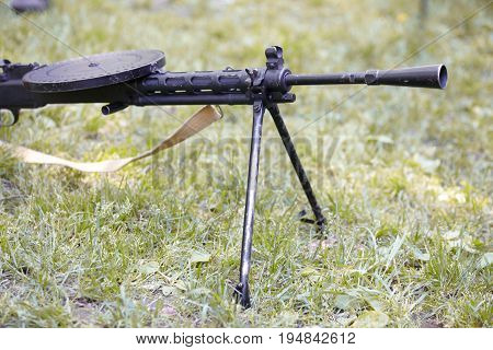Black heavy machine gun in the field