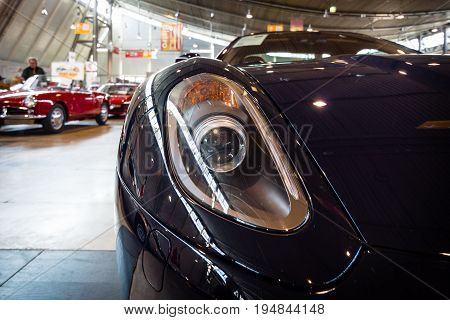 STUTTGART GERMANY - MARCH 18 2016: Headlamp of sports car Ferrari 599 GTB Fiorano F1 2008. Europe's greatest classic car exhibition