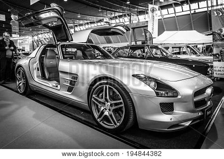 STUTTGART GERMANY - MARCH 18 2016: Supercar Mercedes-Benz SLS AMG 63 Coupe 2010. Black and white. Europe's greatest classic car exhibition