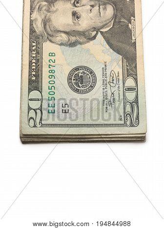 A Stack of Twenty Dollar Bills on a White Background