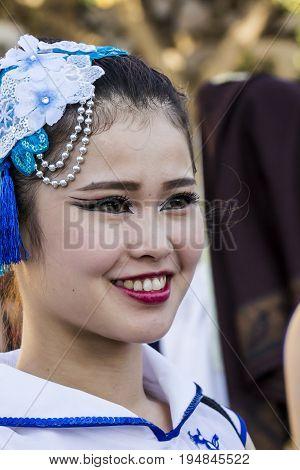 QUARTU S.E. ITALY - JULY 18 2015: 29 Sciampitta - International Folklore Festival - Sardinia - portrait of a beautiful smiling girl in the do-do dance group Of Do-liu, Taiwan