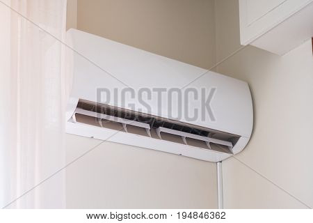Air Conditioner Mounted On The Room Wall For Refreshing Against Summer Heat