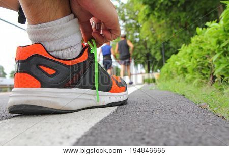 Tie the shoes before running in the park