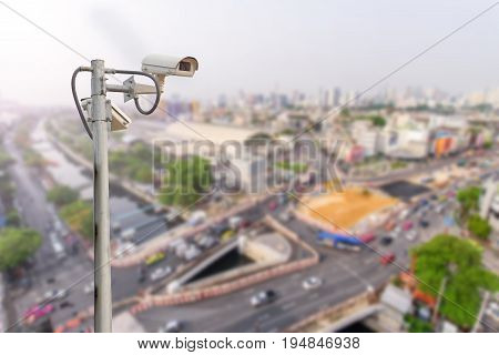 CCTV in city / CCTV and blur city view in background