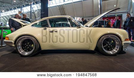 STUTTGART GERMANY - MARCH 18 2016: World premiere of Restomod Porsche 911and 933 equipments by Kaege Retro 2016. Europe's greatest classic car exhibition