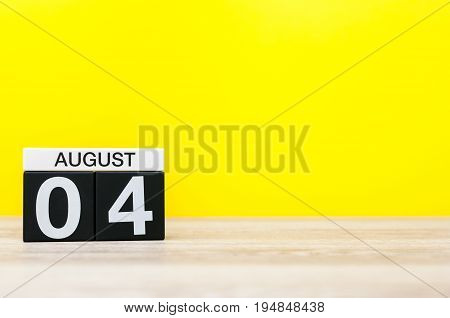 August 4th. Image of august 4, calendar on yellow background with empty space for text. Summer time.