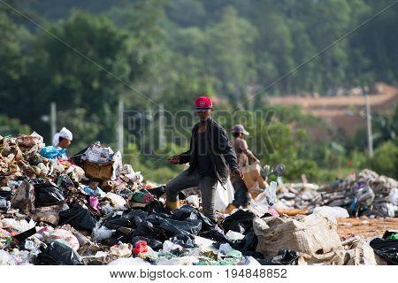 Kota Kinabalu, Malaysia - 09 July, 2017: Unidentified Man Looking Through Rubbish On Landfill Site I