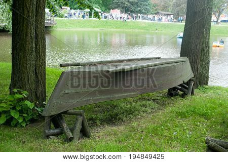 Old upturned rowboat on the shore. Amusement Park.