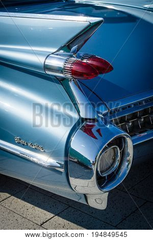 STUTTGART GERMANY - MARCH 18 2016: Detail of the rear wing and brake lights of the car Cadillac Coupe de Ville. Close-up. Europe's greatest classic car exhibition