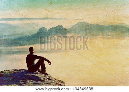 Film Grain. Hiker In Black On The Rocky Peak. Wonderful Daybreak In Mountains, Heavy Mist In Deep Va