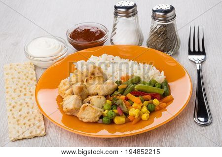 Fried Chicken Meat With Rice, Vegetables, Salt, Pepper, Sauces, Crispbread