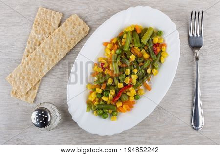 Vegetable Mix In White Dish, Salt, Crispbread And Fork