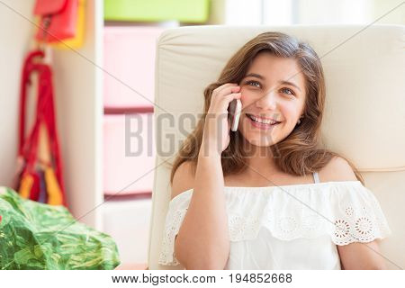 Portrait Of Young Pretty Teenage Girl Speaking With Handy