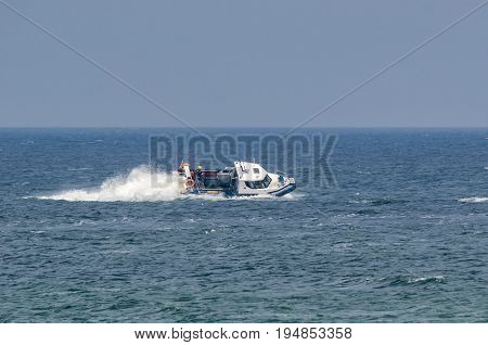 PATROL BOAT - Police boat in patrol action at sea