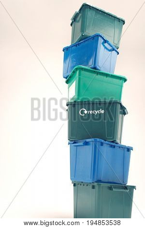 Low angle view of stack of plastic stake isolated over white background