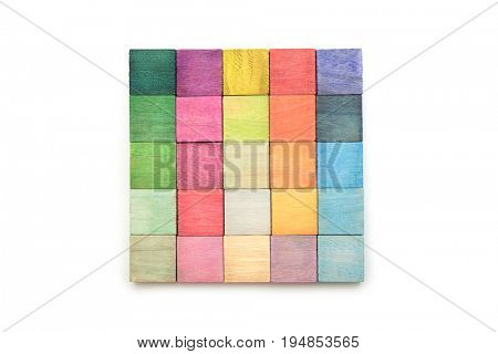 Colorful arrangement of wooden blocks arranged on a natural white background. flat lay or top view.