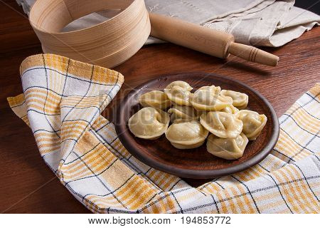Boiled Ukrainian Meat Dumplings Or Ravioli On Wooden Background.