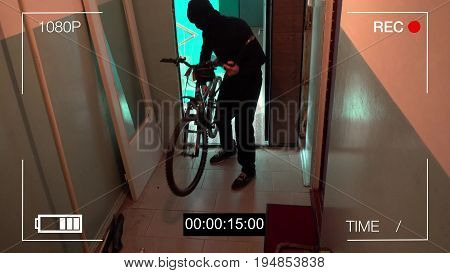 Kursk, Russia, June 30 : surveillance camera caught the thief broke the door and stole the bike.