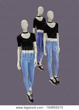 Three female mannequins dressed in casual isolated. No brand names or copyright objects.
