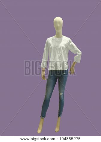 Full-length female mannequin dressed in blue jeans and white blouse isolated. No brand names or copyright objects.