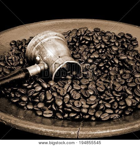 Arab coffee pot and roasted coffee beans
