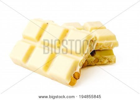 White chocolate with nuts on white background isolated