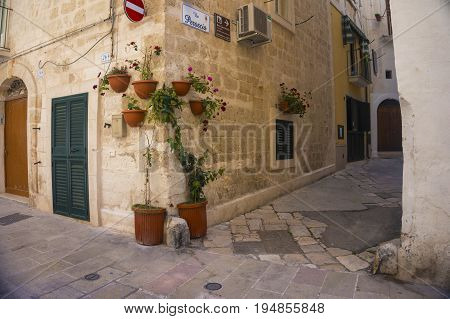 Monopoli, Puglia, Italy - beautiful street with flowers on the building's corner