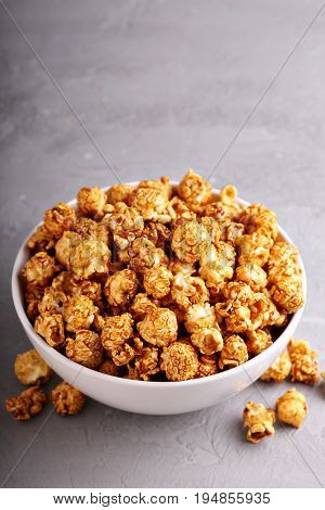Sweet golden caramel flavoured popcorn in a bowl