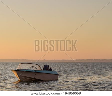 Boat sea and evening is very beautiful no one around soon sunset