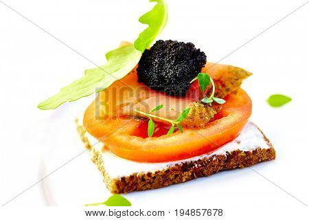 Smoked Salmon with Black Caviar and Tomato on Bread