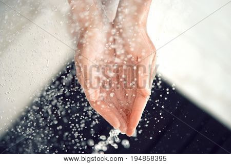 Cupped Hands in Water