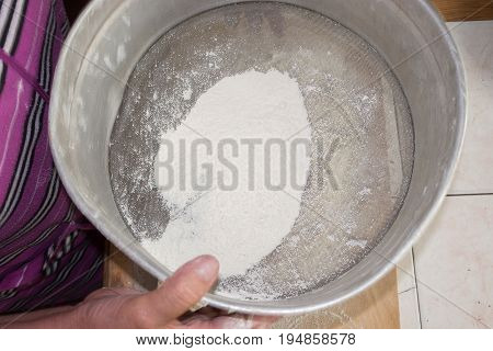 Sifting the flour in a sieve. Top view