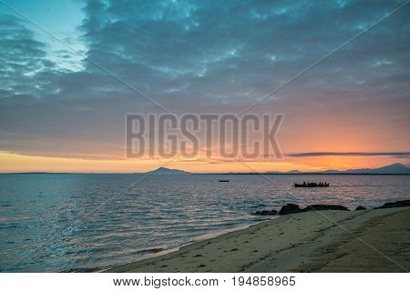 Fishermans rowing in a boat at sunrise Madagascar