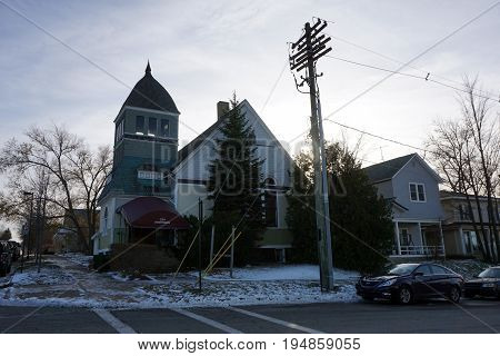 PETOSKEY, MICHIGAN / UNITED STATES - NOVEMBER 22, 2016: A former church building sits vacant on Michigan Street in downtown Petoskey.