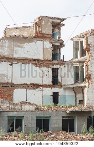 The old destroyed brick multi-storey building. Destroyed Ruined Building