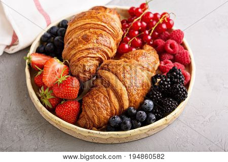Healthy breakfast with freshly baked croissants and fresh berries