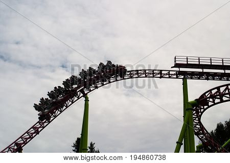 Saint Petersburg Russia - July 08 2017: Visitors to the amusement Park and ride on the roller coaster. Divo-Ostrov - rides.