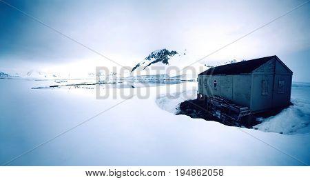 Shack in Winter Landscape