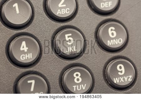 Modern IP digital phone buttons with numbers close up with selective focus. Toned.