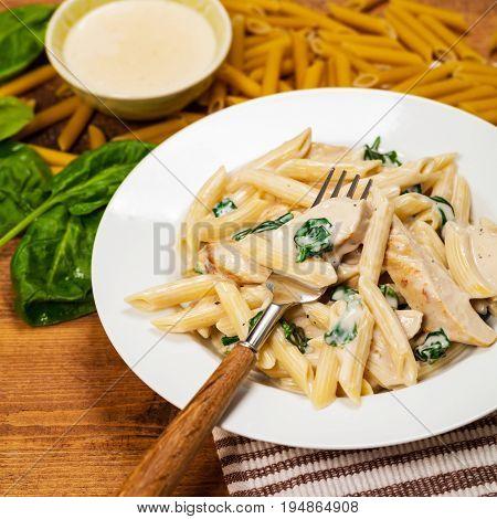 Chicken Alfredo Spinach Parmesan Pasta. Selective focus.